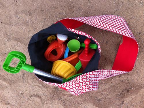Sandspielzeugtasche voll